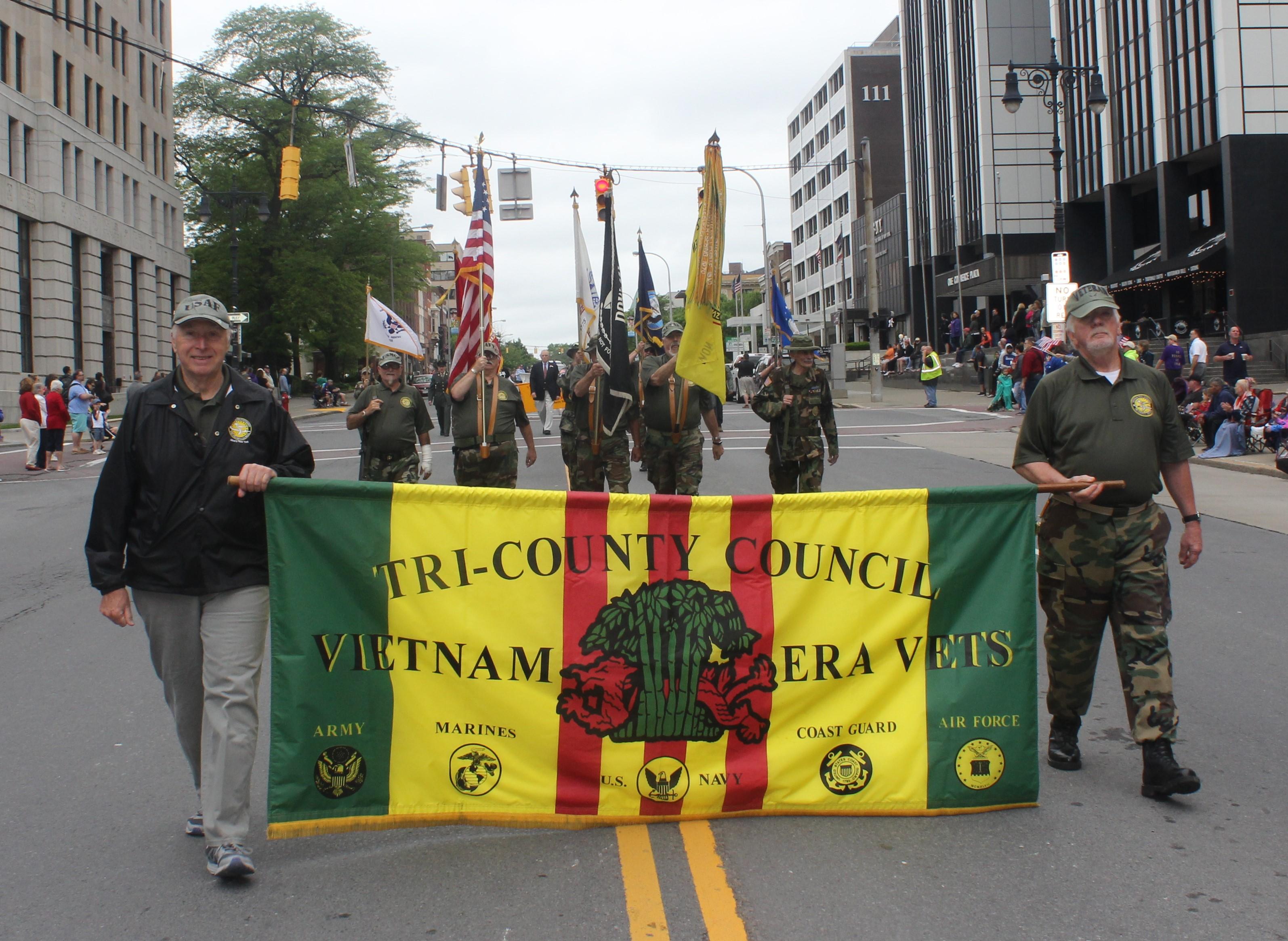 Tri-County Council Vietnam Era Veterans Parade Holding Banner