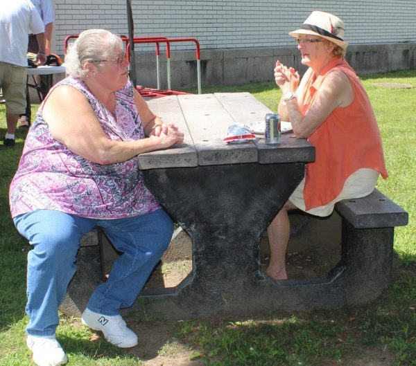 Tri-County Council Vietnam Era Veterans Ladies Sitting on Picnic Table