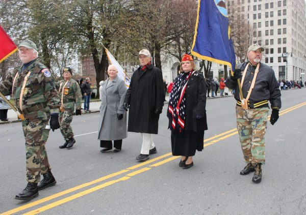 Tri-County Council Vietnam Era Veterans Members in Parade wearing camouflage