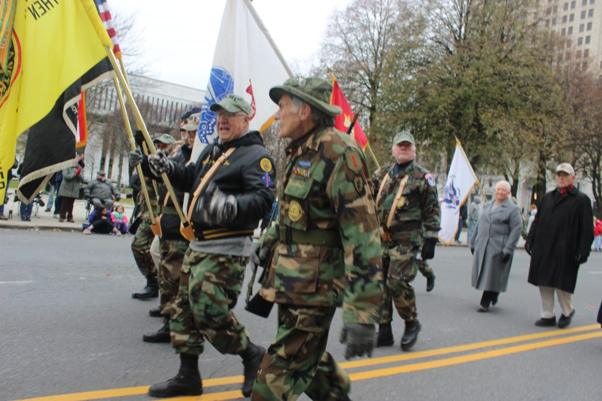 Tri-County Council Vietnam Era Veterans Group Photo in Parade wearing camouflage